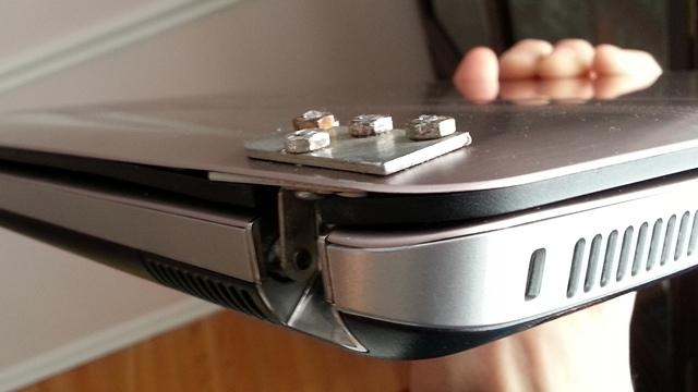 Laptop hinge reinforced with screws